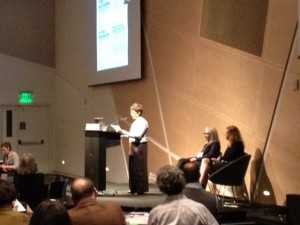 """Rabbi Noa Cushner speaking about her spiritual """"start-up,"""" The Kitchen, during the March 8 plenary session"""